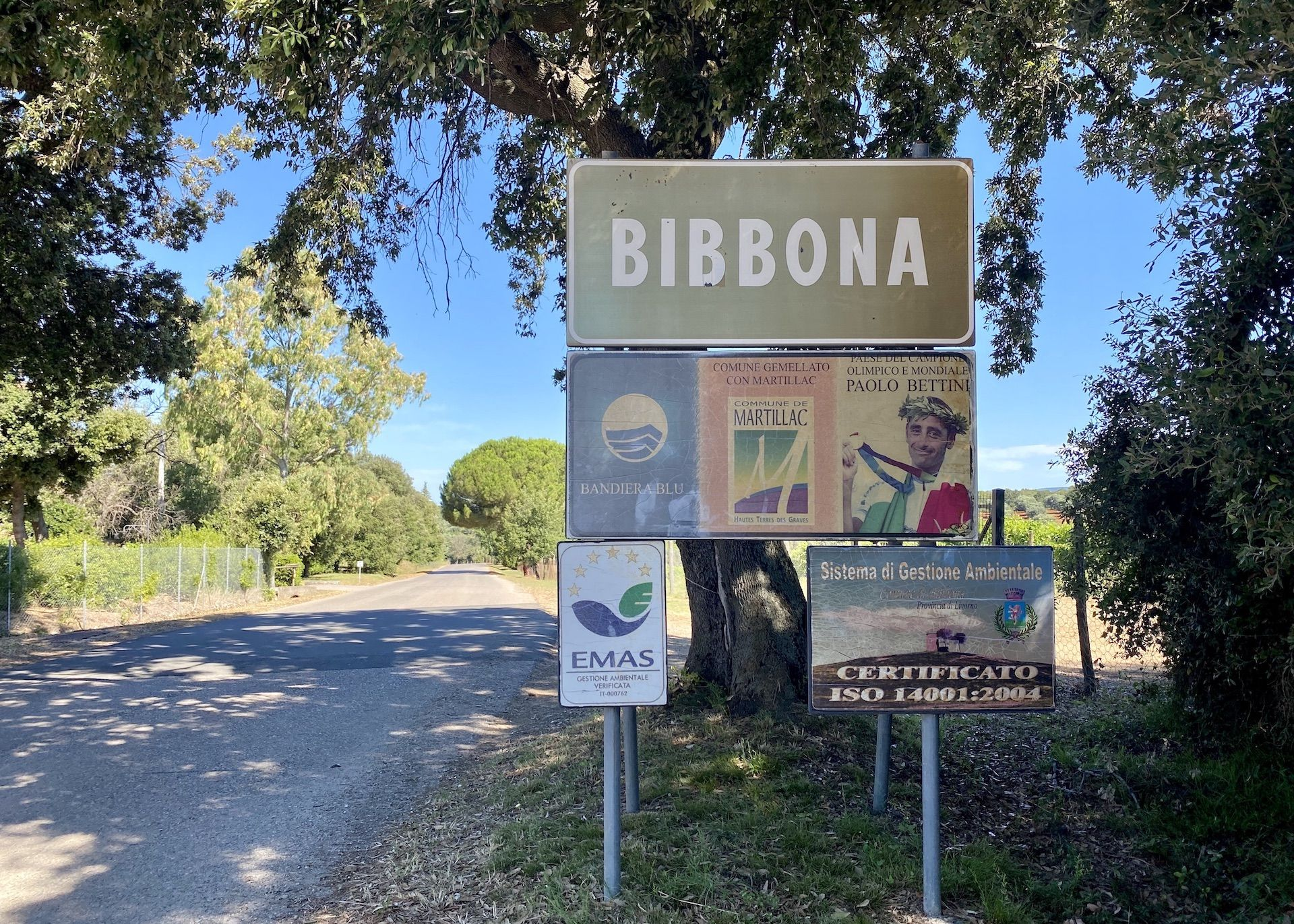 Bibbona town sign with Paolo Bettini